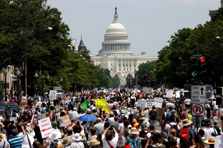 Immigration activists march to protest the Trump Administration's immigration policy in Washington